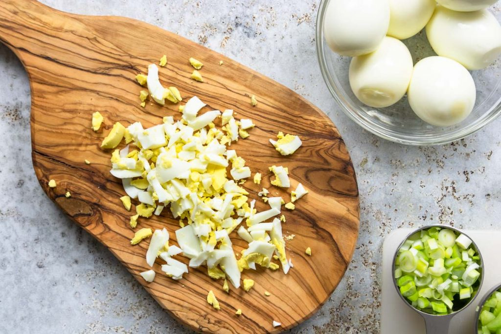 hard boiled egg chopped on a cutting board