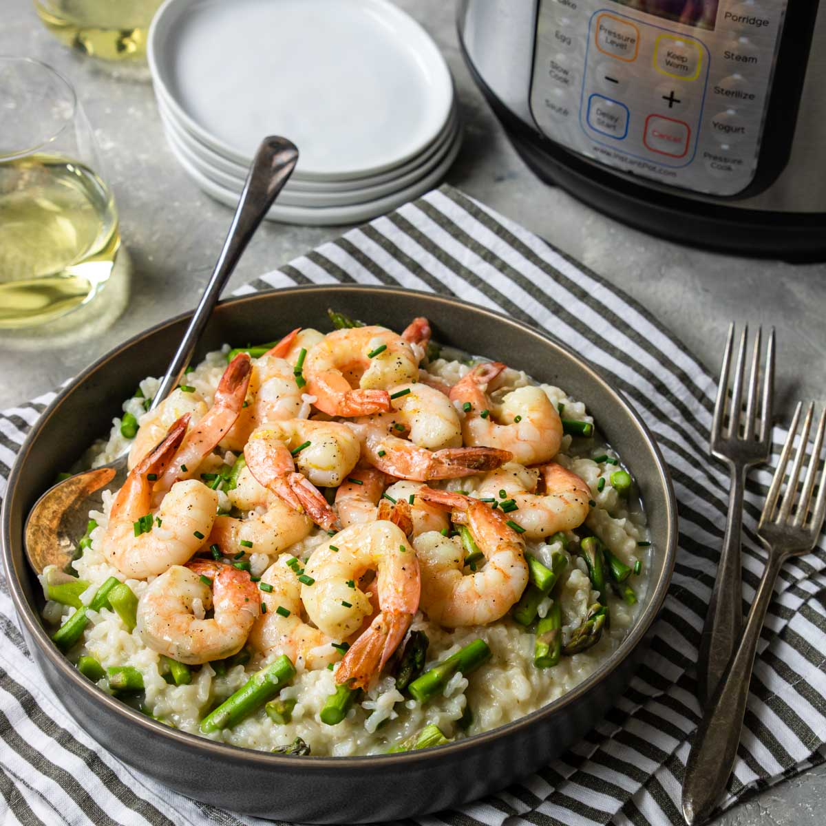 Instant Pot Shrimp Risotto in a bowl with an Instant Pot on the counter