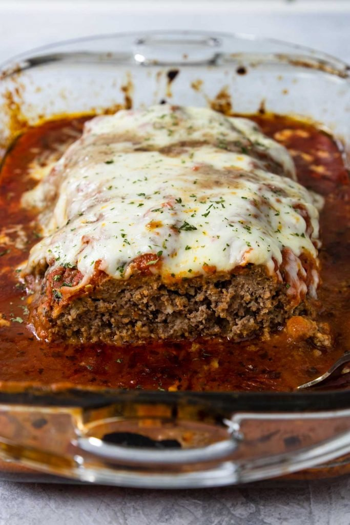 Italian Meatloaf in a baking dish topped with cheese