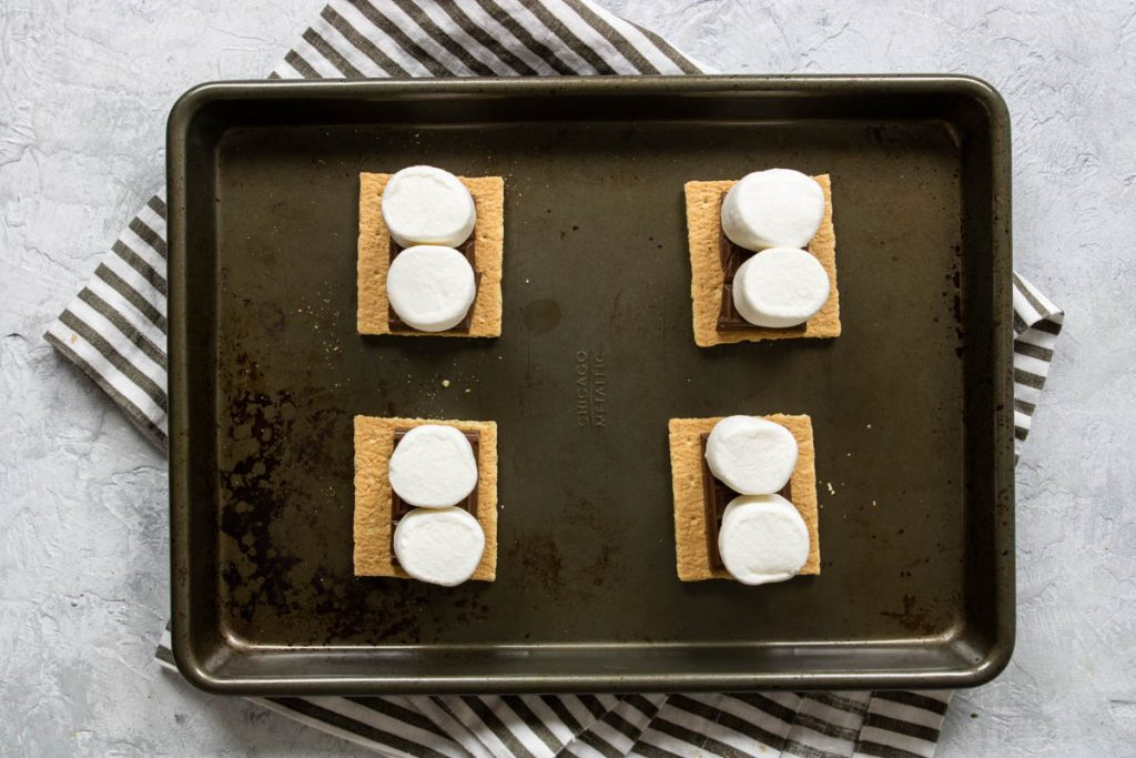 graham crackers topped with hershey bars and marshmallows