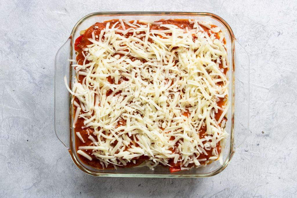 last layer of veggie lasagna - two noodles, sauce and cheese