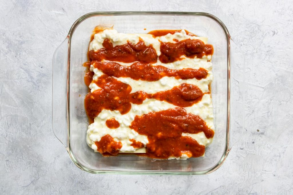 Layering Veggie Lasagna - noodles, cottage cheese and sauce