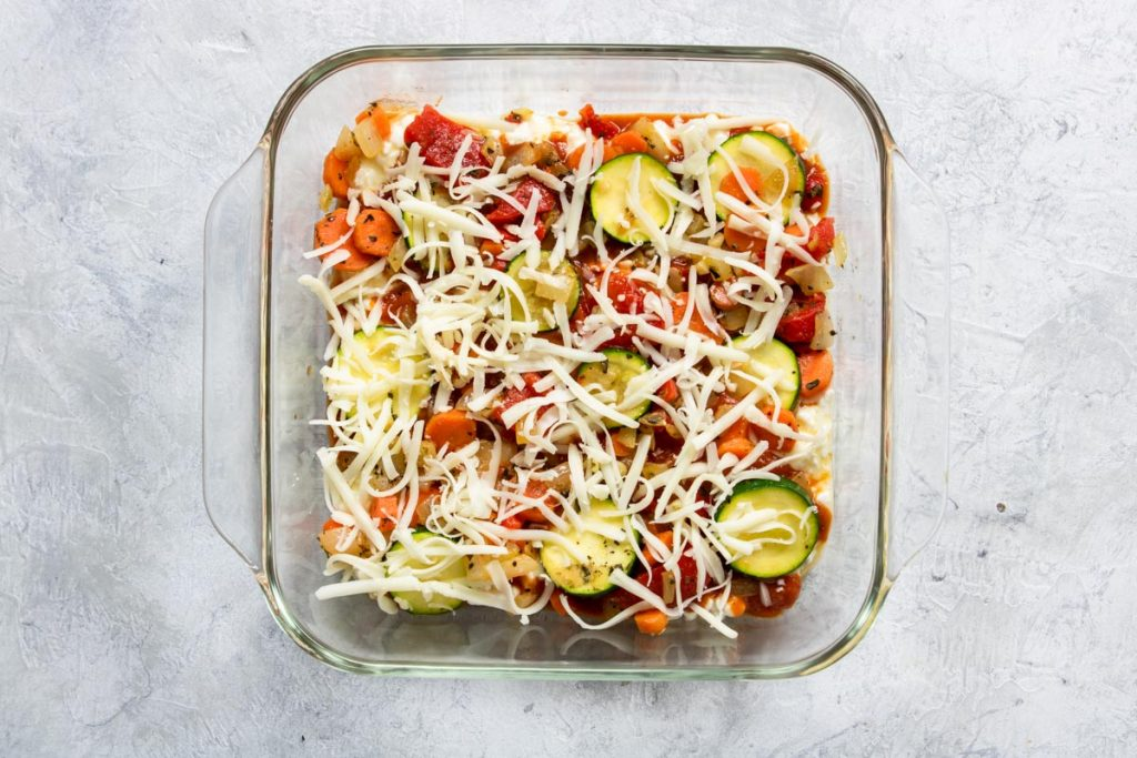Layering Veggie Lasagna - noodles, cottage cheese, sauce, veggies and cheese