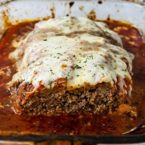 Italian Meatloaf in a pan, with one slice cut