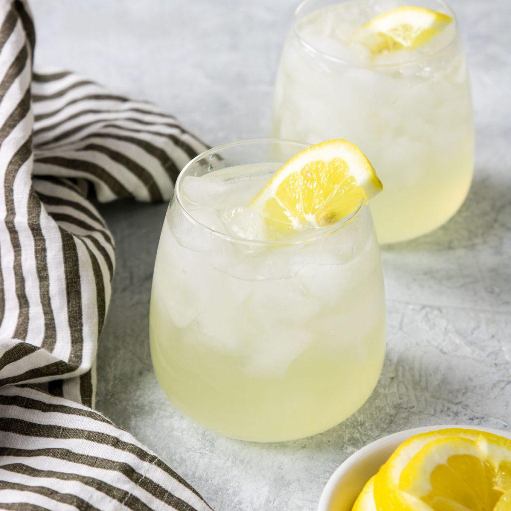 Vodka and Lemonade garnished with a fresh lemon