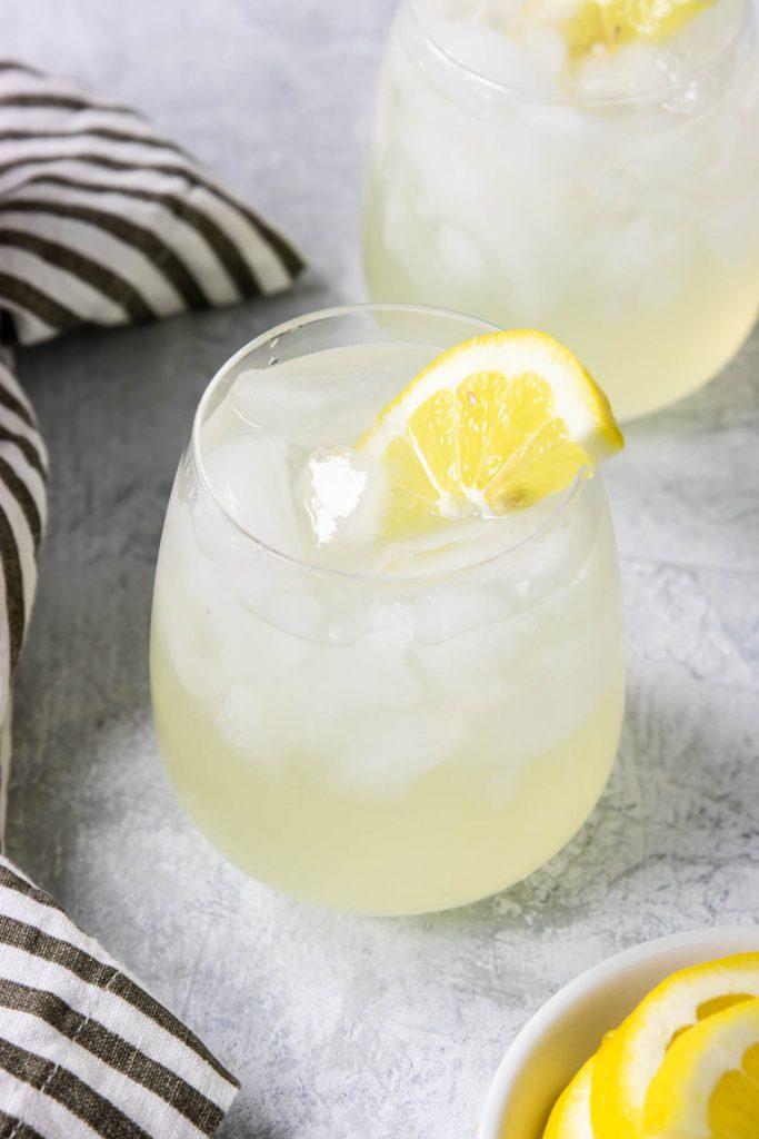 Vodka Lemonade recipe in a glass with a lemon wedge
