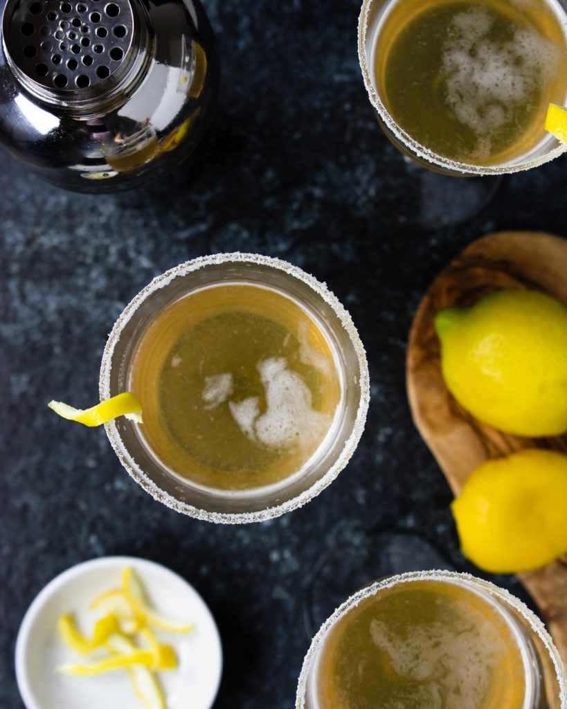 overhead shot of a sugar rimmed cocktail glass with a lemon twist