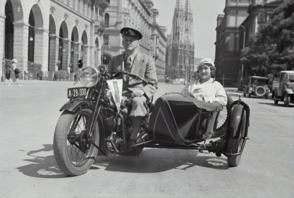 a black and white old photo of a motorcycle with a side car