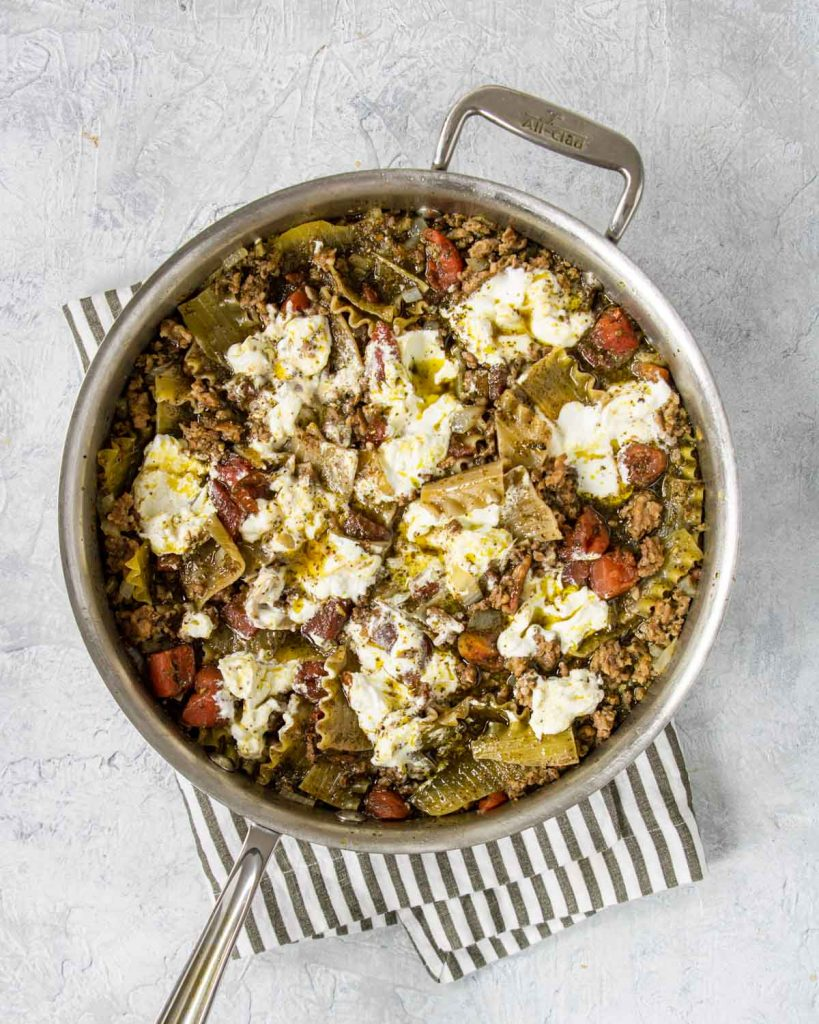 ricotta added to the lasagna skillet