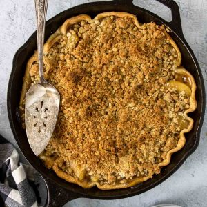skillet apple pie with crumble topping in a cast iron skillet