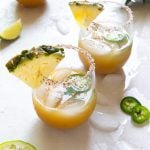 pineapple jalapeno tequila in glass with pineapple garnish