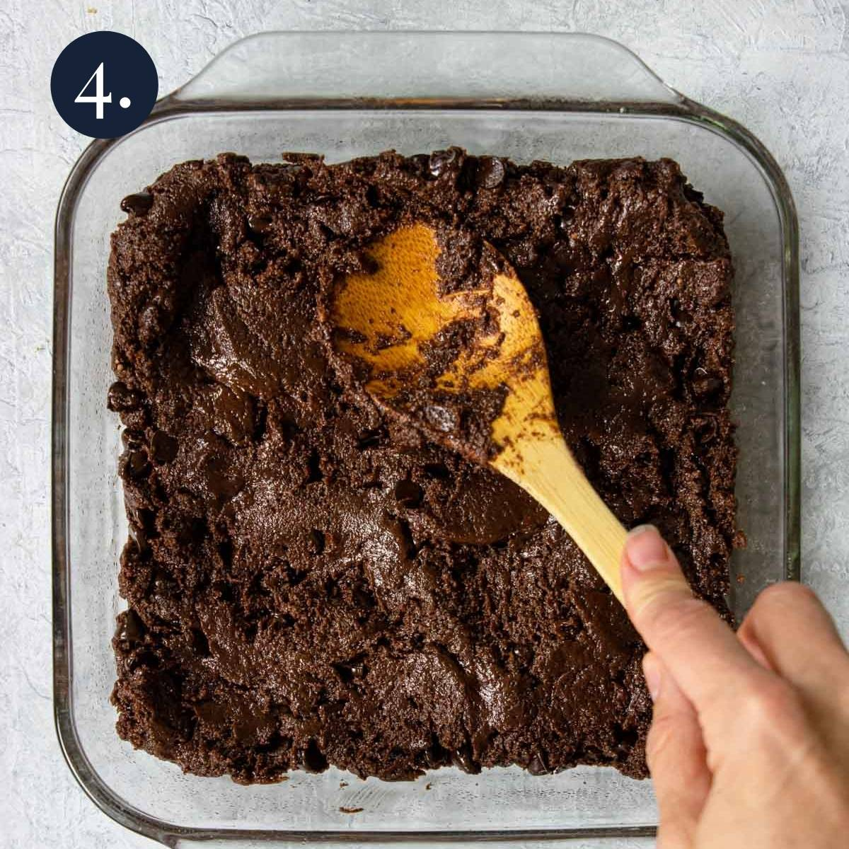 pressing brownie batter into a 9x9 pan