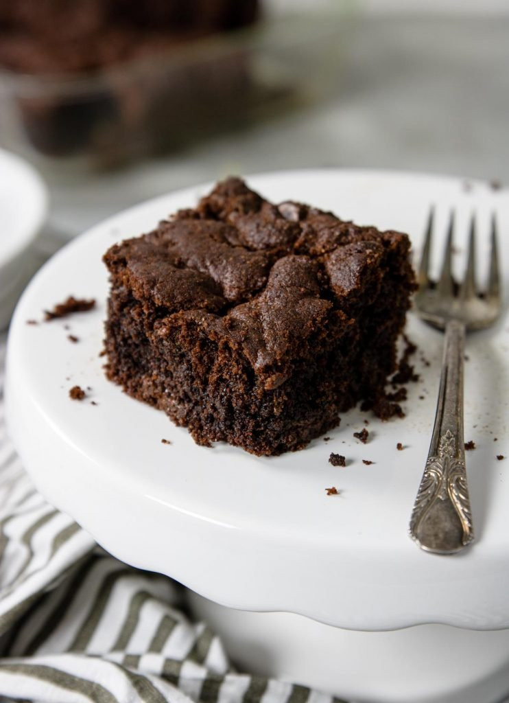 cake mix brownie on a cake plate with a fork