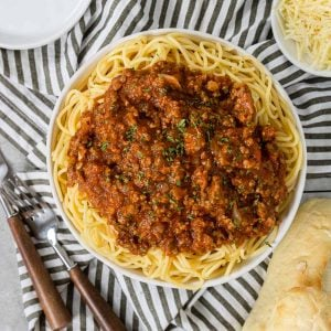 spaghetti with meat sauce recipe on a black and white napkin