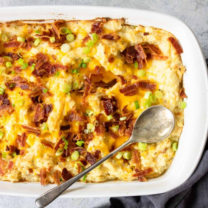 loaded twice baked potato casserole topped with bacon and green onions