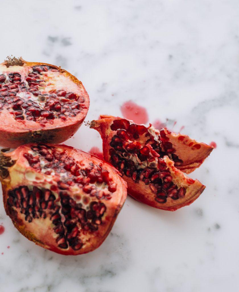 A fresh pomegranate cut in pieces