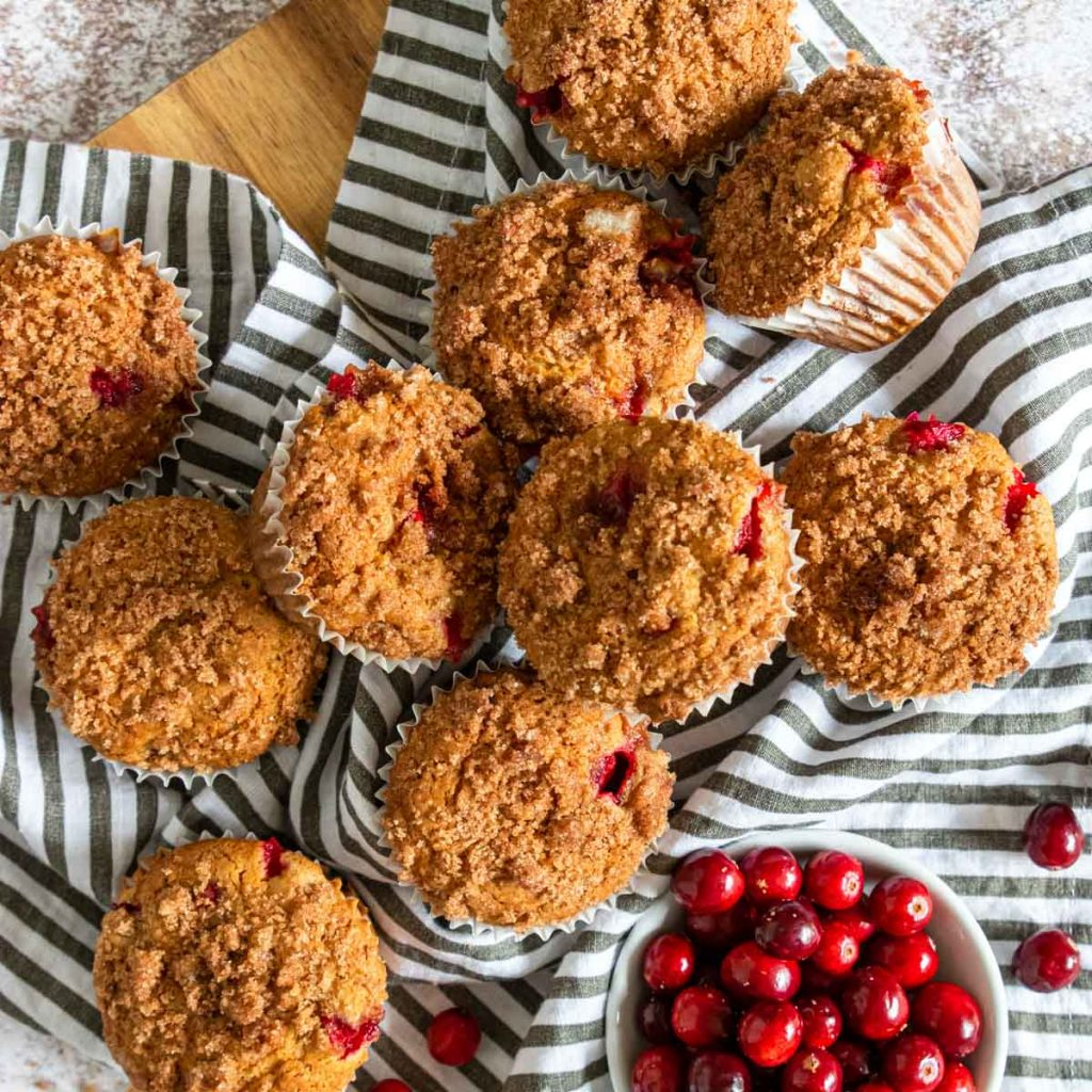 cranberry orange muffins on a black and white napkin