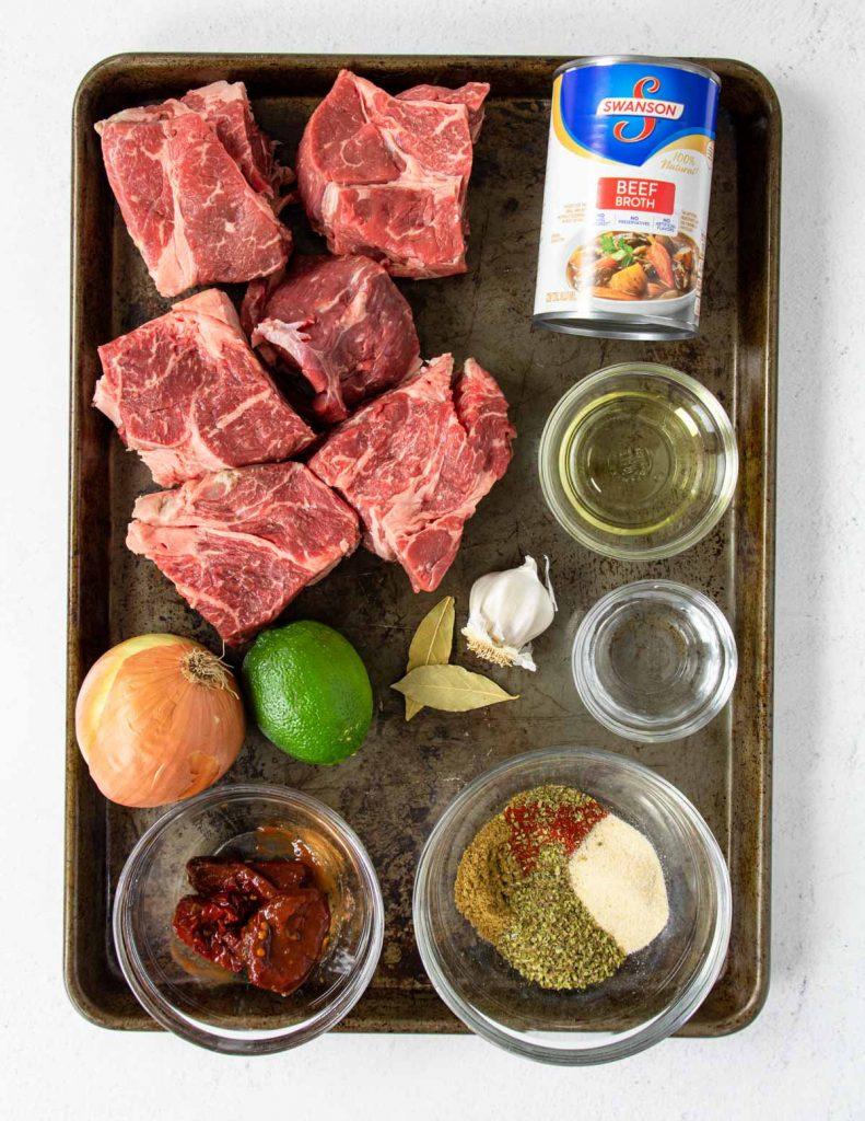 ingredients to make barbacoa on a baking sheet