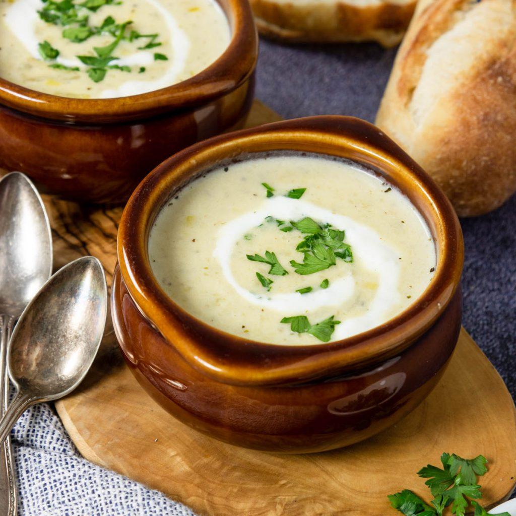 a brown crock full of potato leek soup
