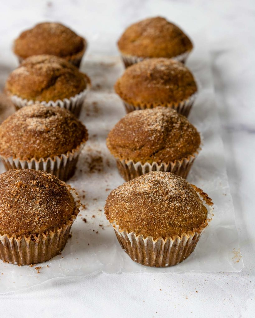 snickerdoodle muffins on a piece of wax paper
