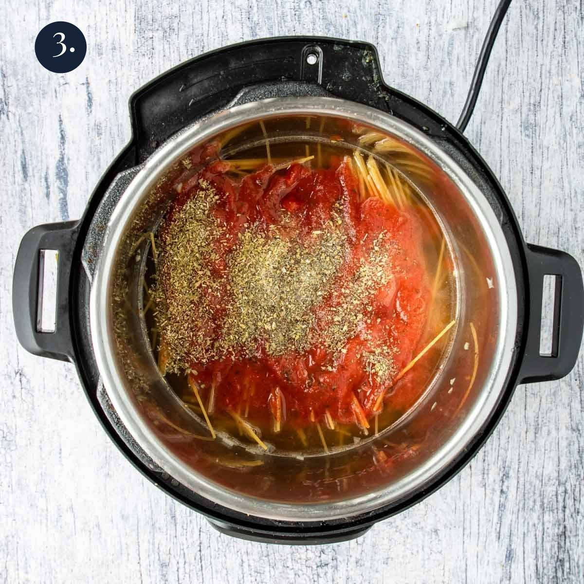marinara sauce on top of spaghetti in the instant pot