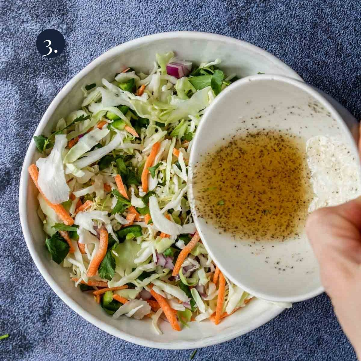 pouring dressing over slaw