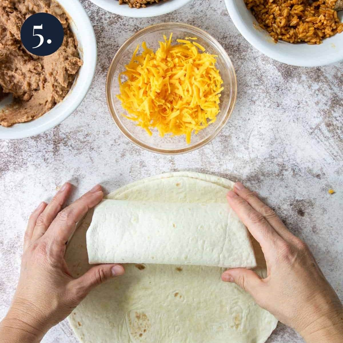 a rolled up burrito in a flour tortilla