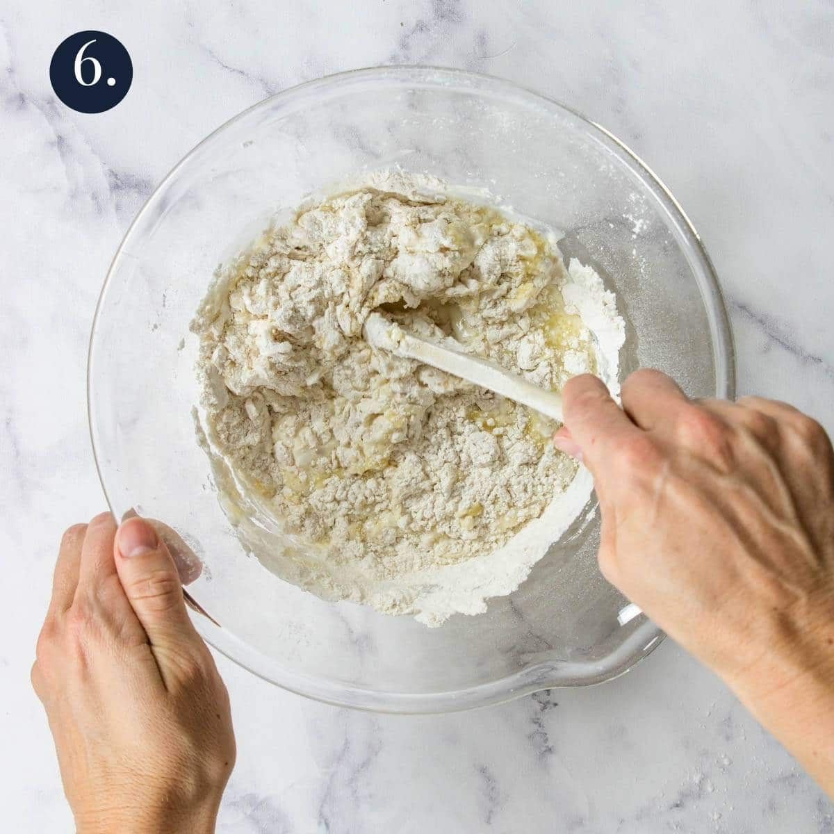 stirring dough in a glass bowl