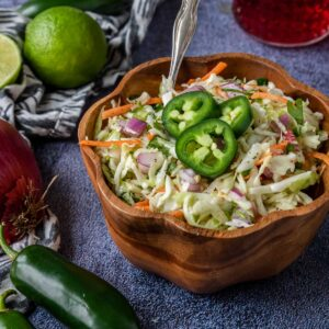 a wooden bowl of cilantro lime slaw