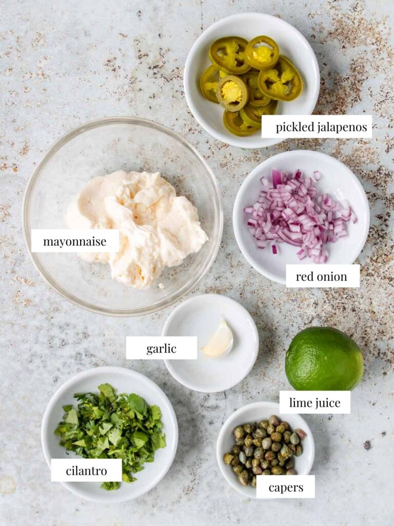 ingredients for jalapeno tartar sauce on a table with labels