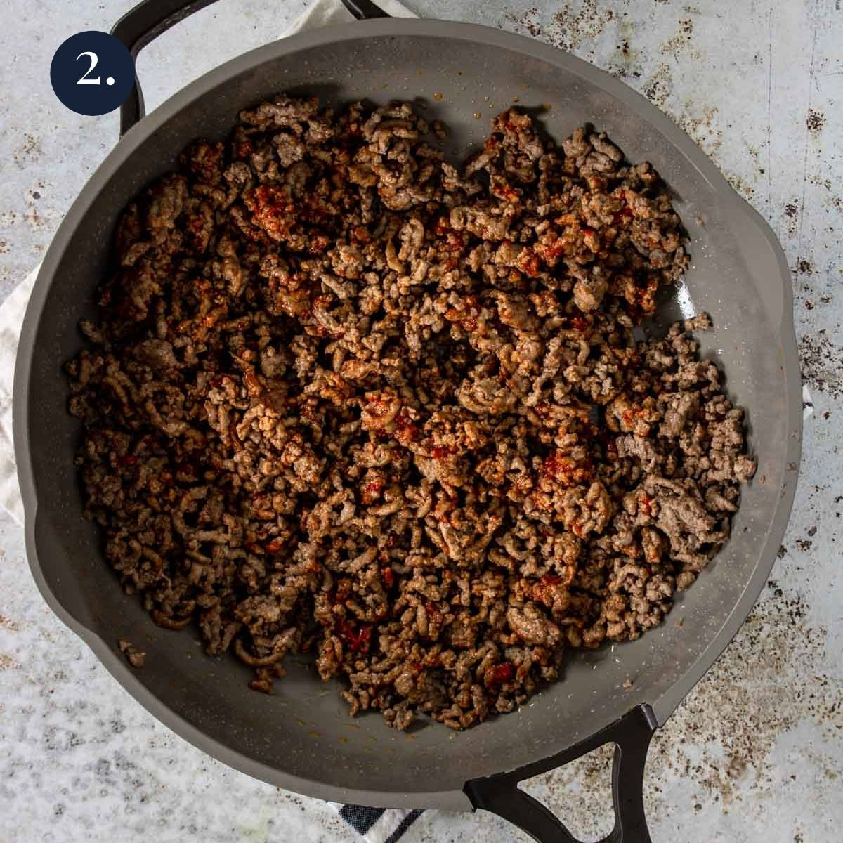 ground beef coated in tomato paste