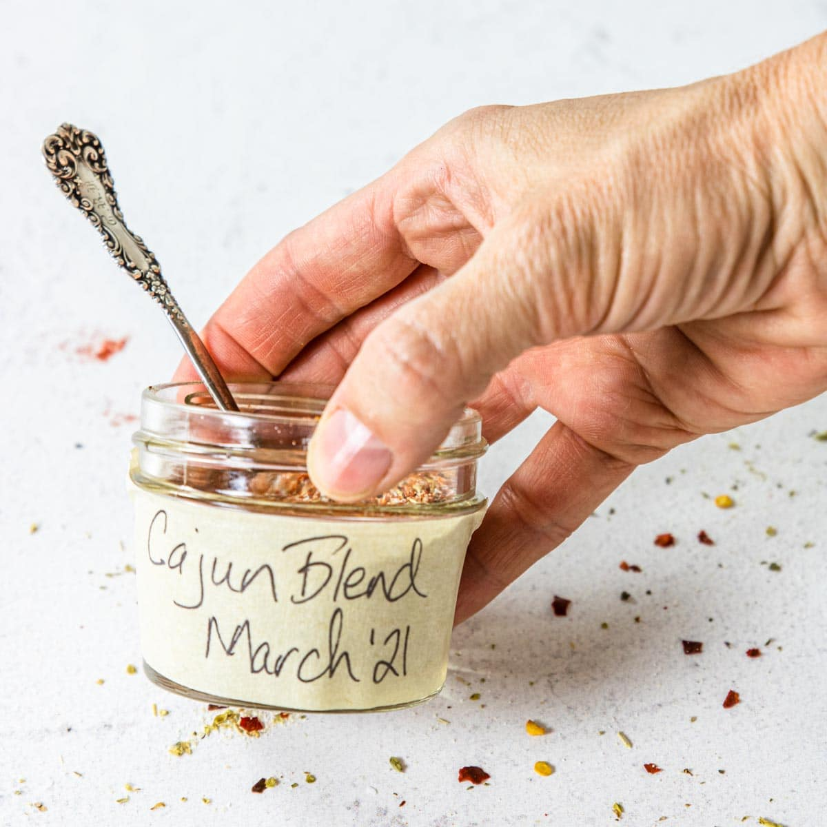 a mason jar with a label on the side that says Cajun Blend March 2021