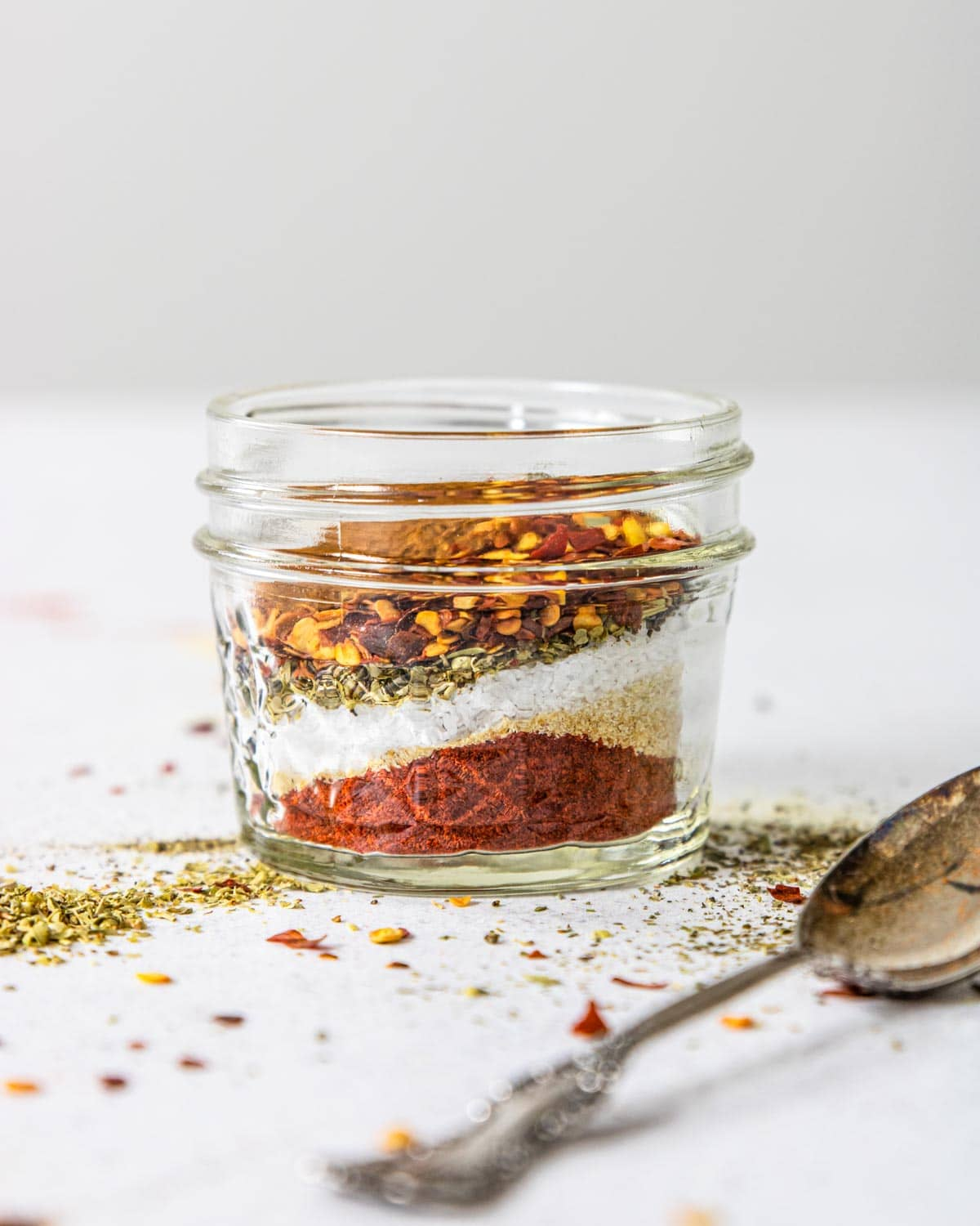 a jar that has defined layers of spices and seasonings