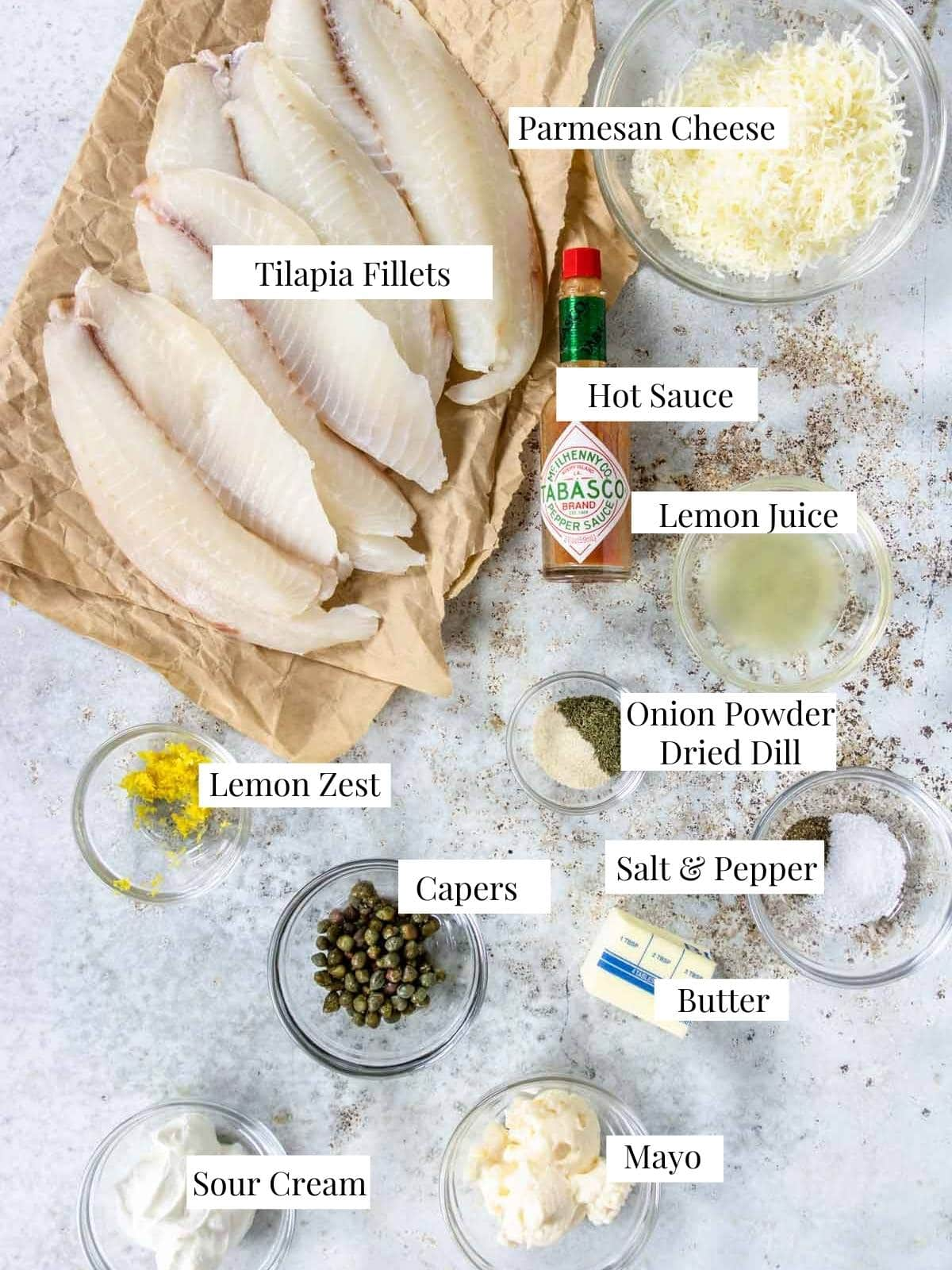 parmesan tilapia ingredients on a table with text labels